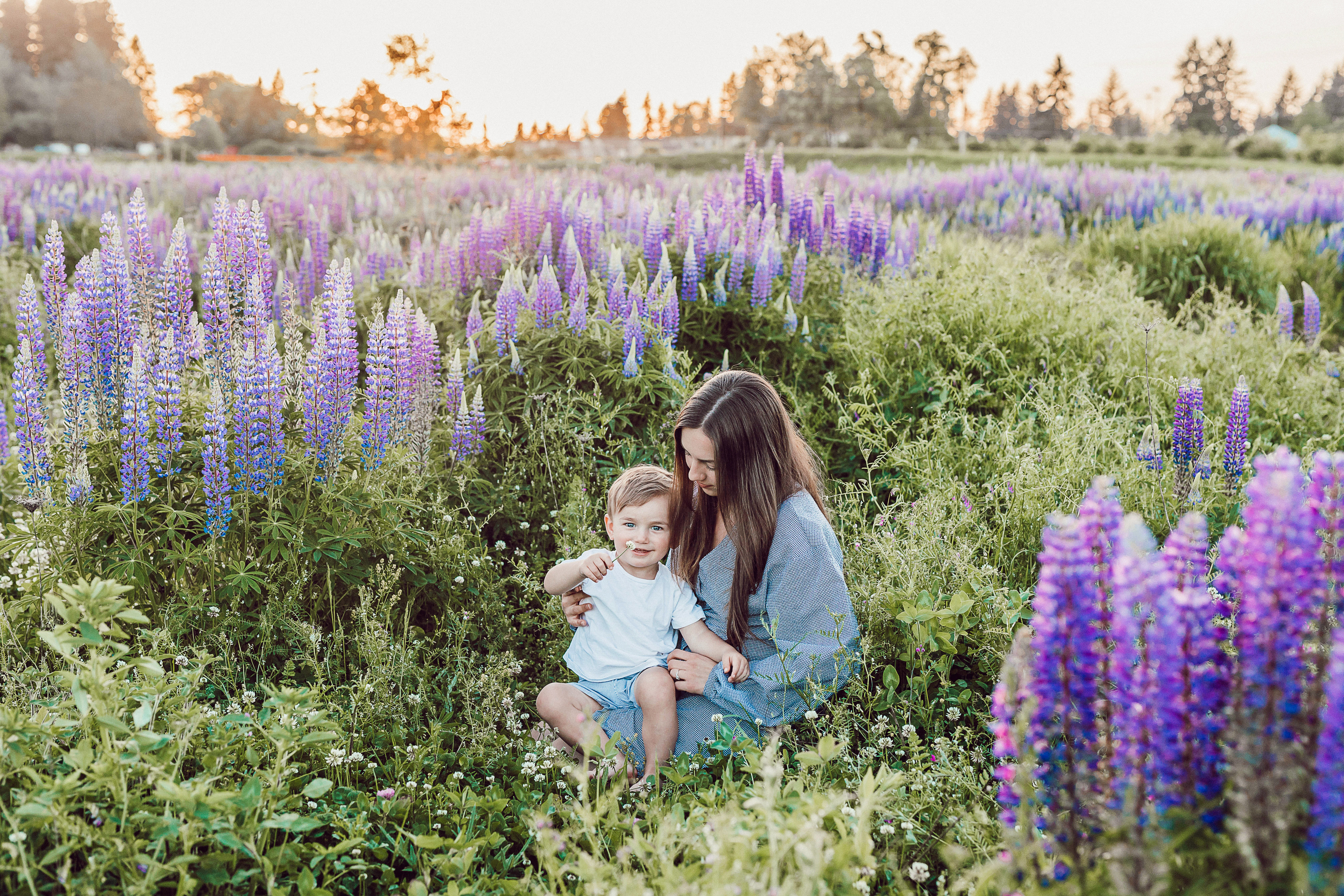 mother and child in field with purple flowers