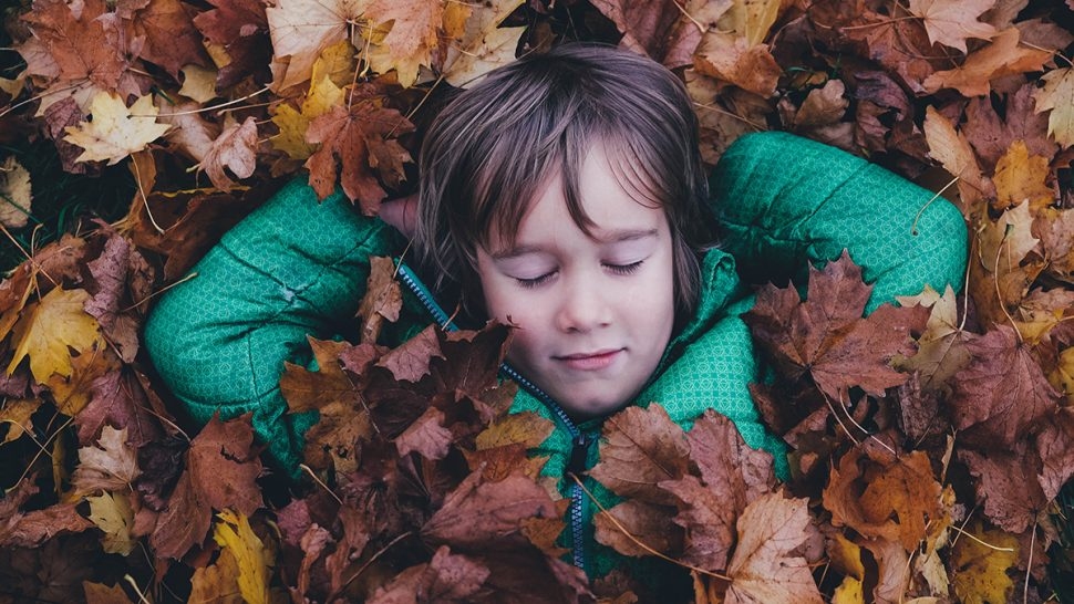 Sleep Problems and Autism, child in leaves