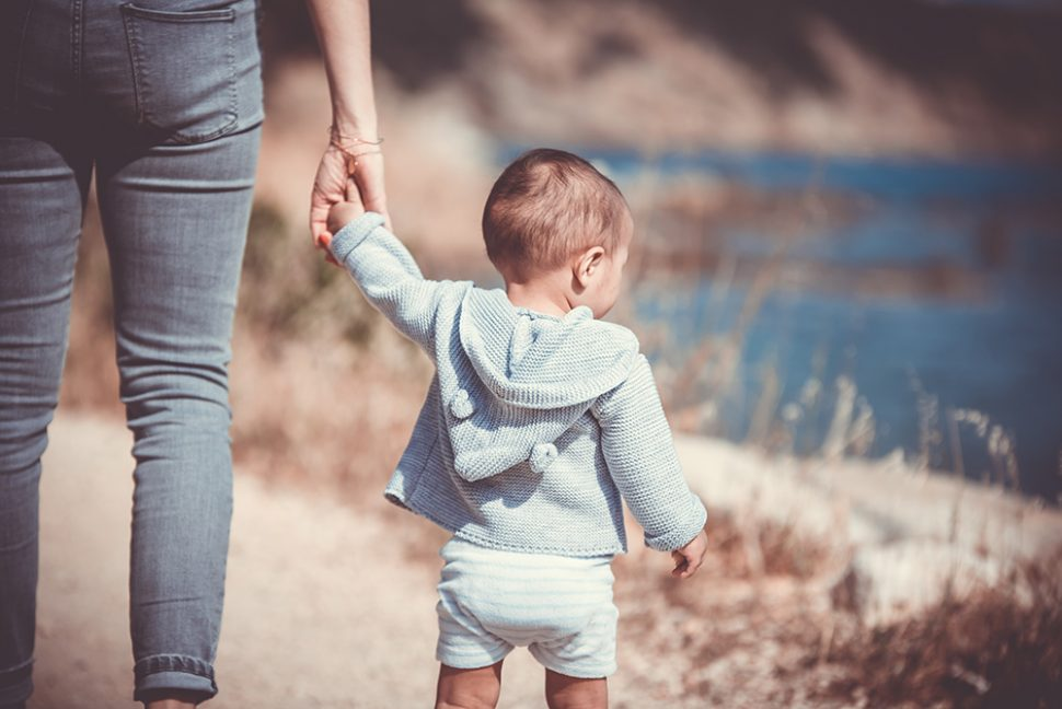 coping with parental stress, mother and child walking