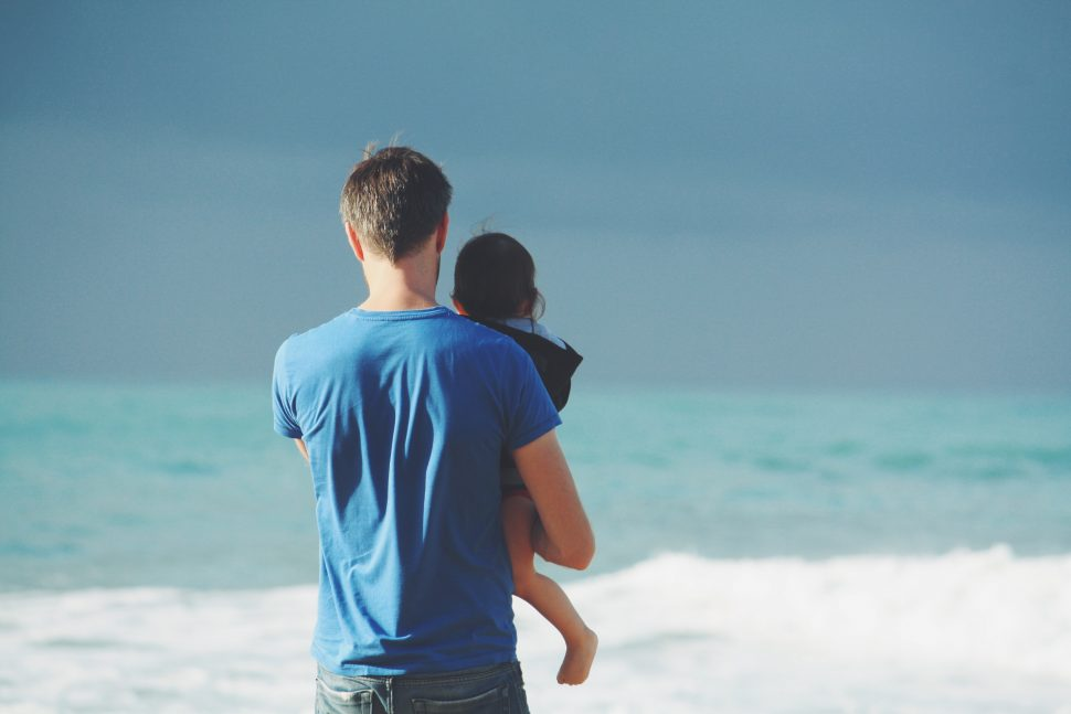 signs of autism man on beach with child
