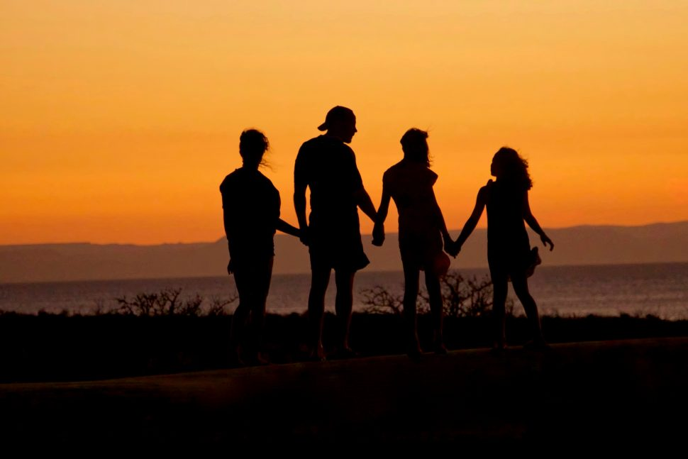 Family Standing on the Beach at Sunset with Sensory Processing Disorder