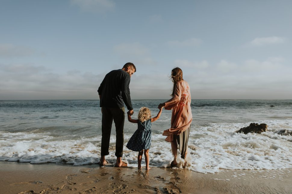Family on the beach with a child with autism spectrum disorder
