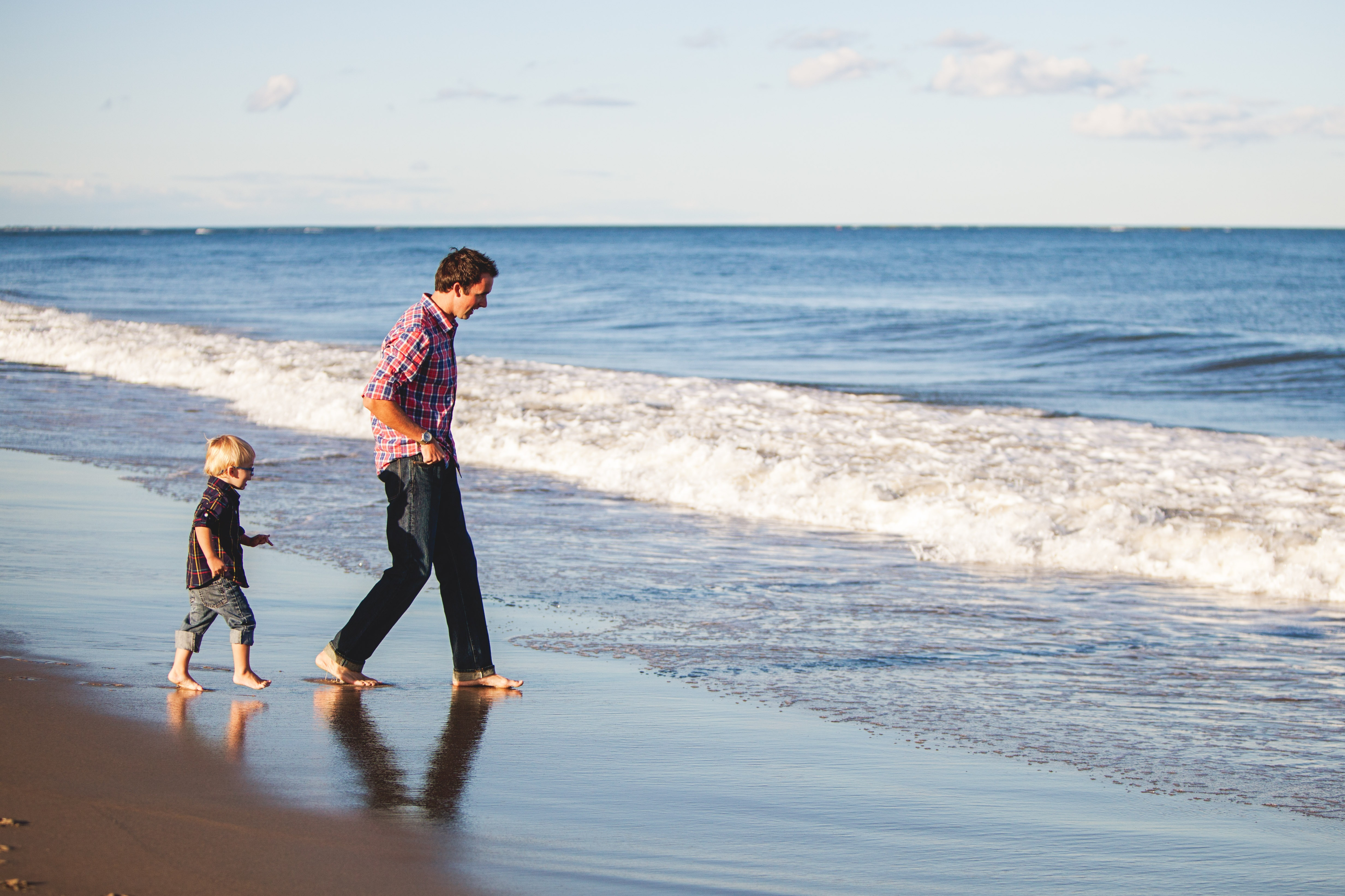 Man on the beach with his son for autism home services