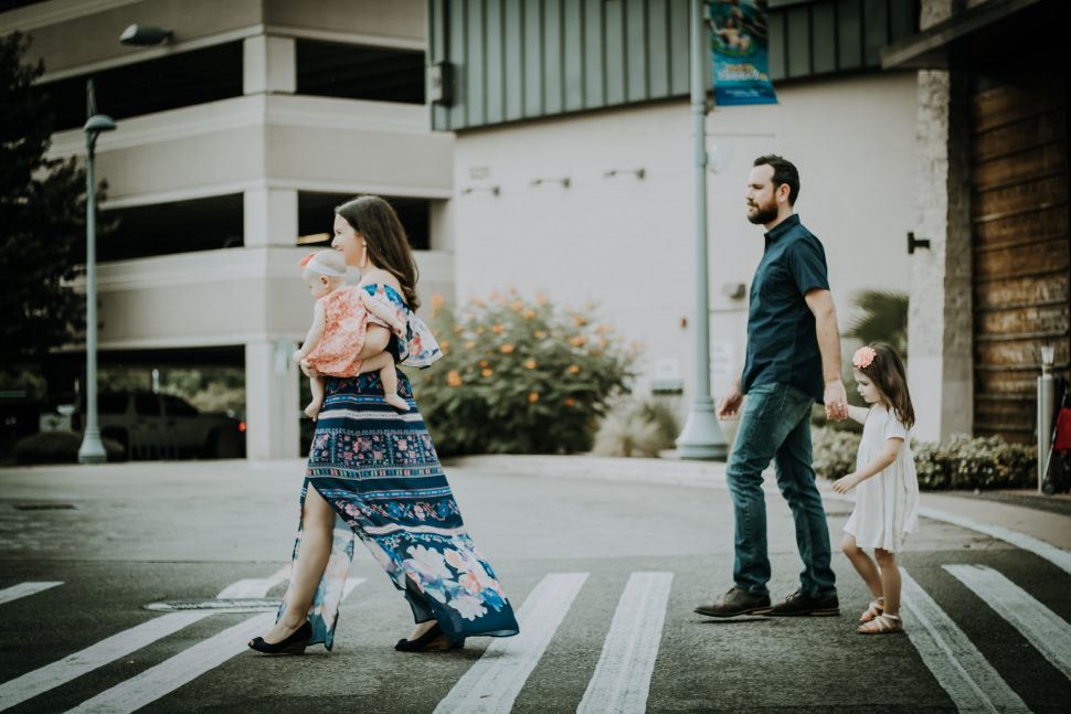 Family walking across the street after autism therapy