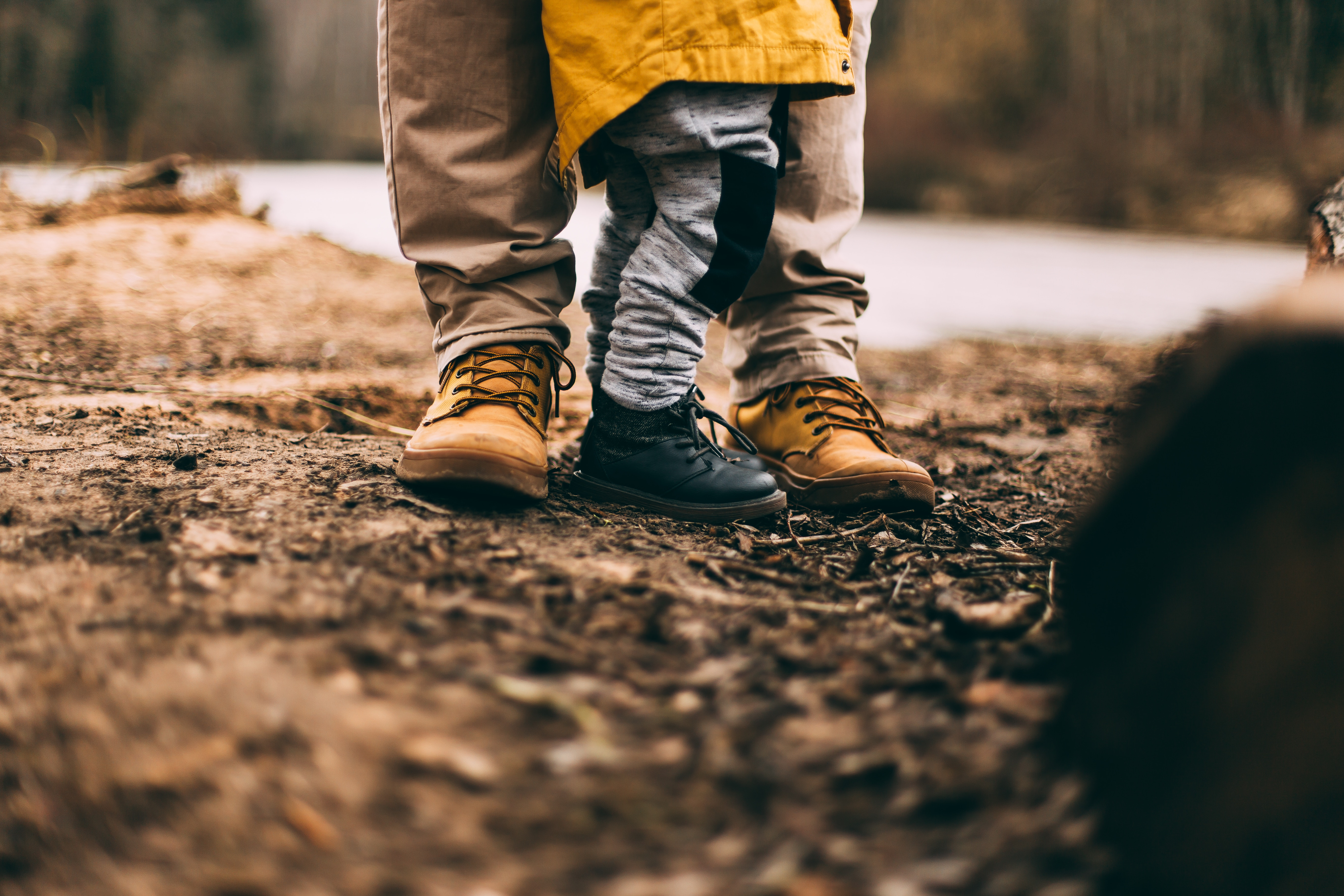 family with a child with autism in the woods