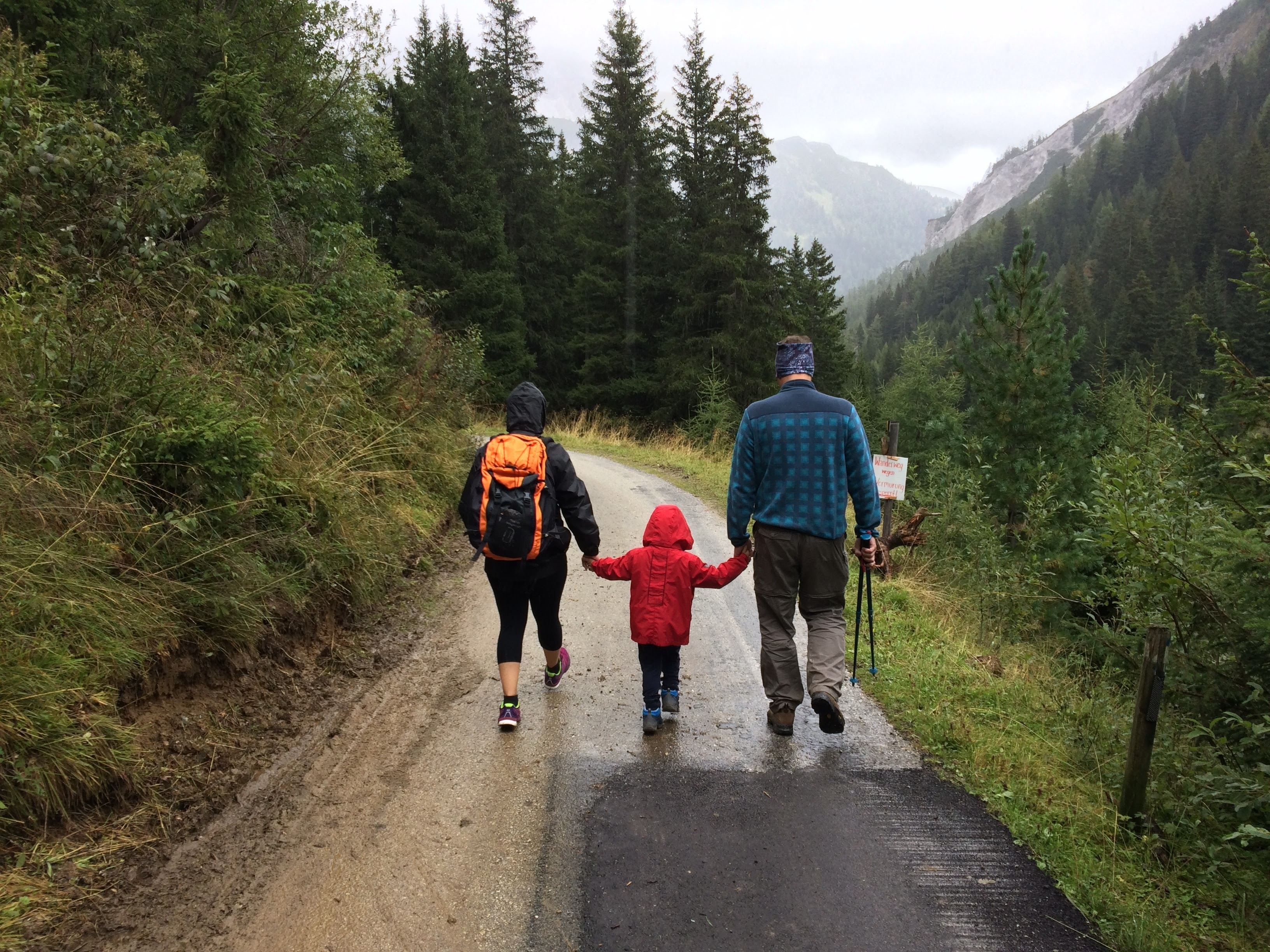 family walking down a road in the mountains for physical therapy
