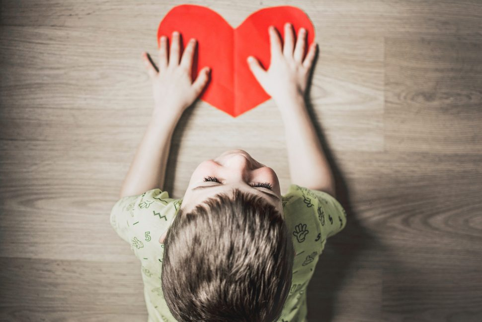 Child preventing bullying with a red heart